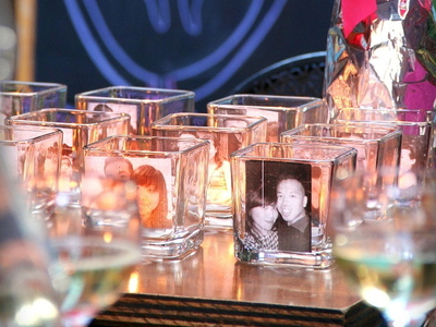 Daniel Chan decorated the Mudspot Cafe on East 9th Street with images of him and his now-fiancee in front of candles.