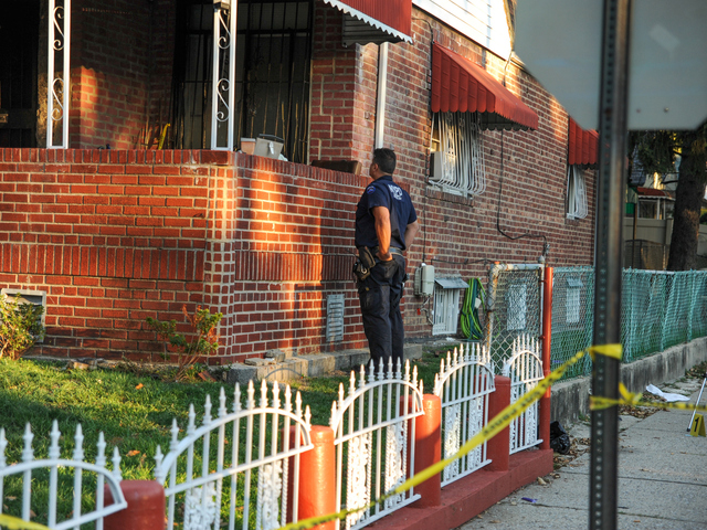 Police search for evidence at the scene of a fatal shooting in Brooklyn on Tuesday September 25th, 2012.