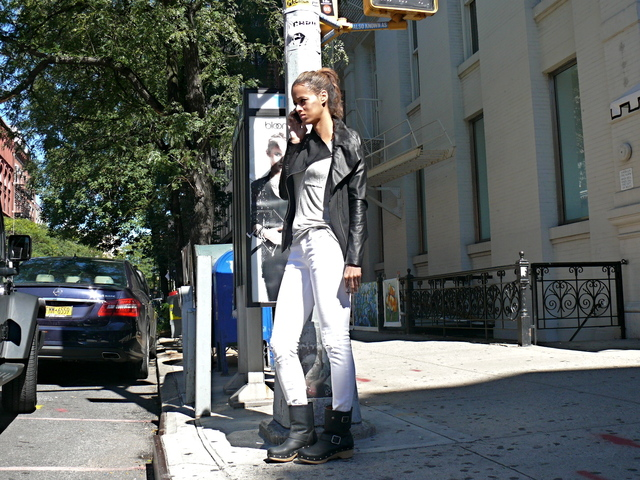 draped asymmetric leather jacket, with emphasis on falling collar and distressed white denim
