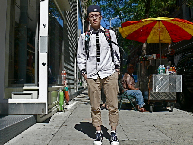 Kenji in  hip black and white shirt details in SoHo