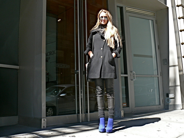 Greta F. in a tailored with leather pants light mesh leggings and blue suade boots