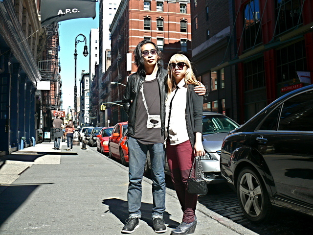 Mike M. and Tuyet N. in in graphic tops paired with leather  and cardigan looks in SoHo