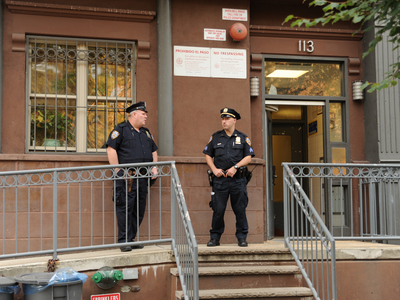 <p>Officers stand guard outside of 113 Morningside Avenue in Harlem where a man was shot dead by cops. Photo taken Wednesday September 26th, 2012.</p>