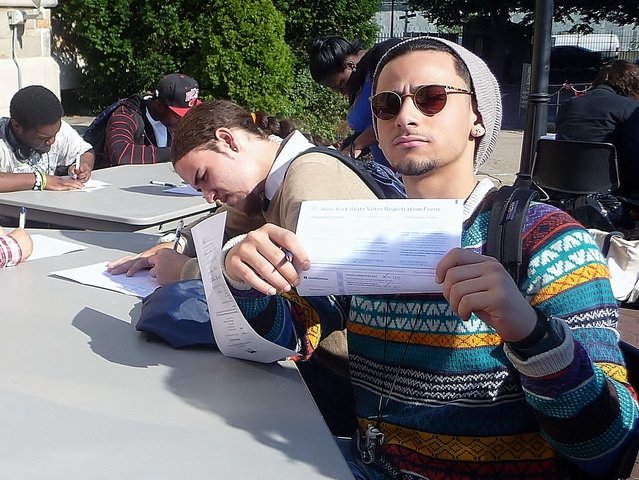 Bronx resident Eli Ramos, 18, fills out a voter registration form for the first time.