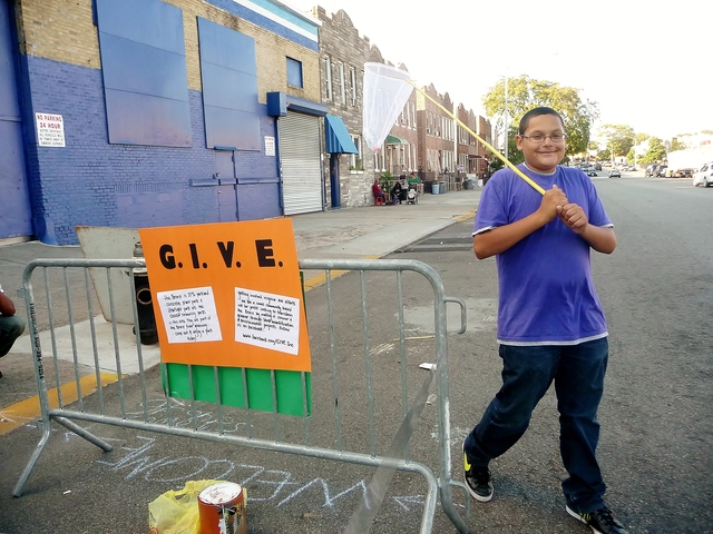 Park(ing) Day is a movement where residents convert parking spots into temporary public park spaces. G.I.V.E, a neighborhood group in Parkchester, was behind one of Friday's sites in the Bronx.
