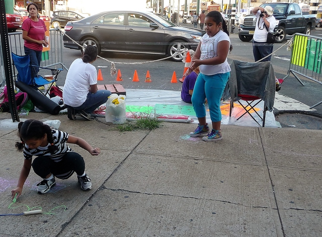 Members of the Parkchester-based neighborhood improvement group G.I.V.E participated in Park(ing) Day on Friday, an international event where residents convert parking spots into temporary public parks.