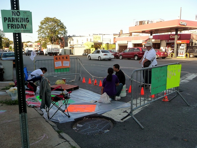 The group set up their space at the corner of Bronx River Avenue and Westchester Avenue, laying a plastic tarp on the ground between cones and parking barriers.