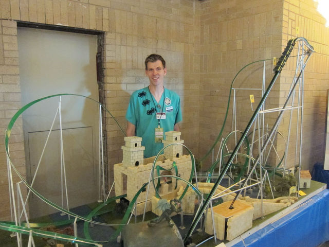 Randal Strong-Wallace shows off his roller coaster model at Maker Faire.