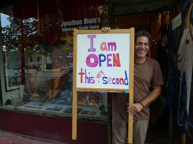 Painter Jonathan Blum also has a sign in his storefront studio that says,