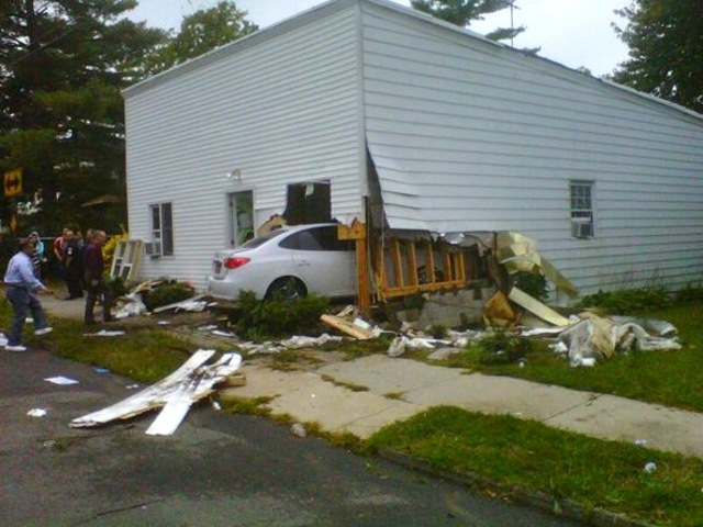 <p>A Hyundai crashed into a home on Arthur Kill Road on Staten Island on Sept. 28, 2012.</p>