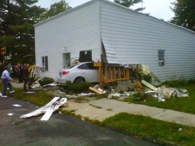 A 5-year-old girl and her mom were hurt when an out-of-control car crashed into their Staten Island home on Sept. 28, 2012.