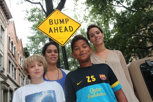 <p>Zuhri Sinclair and Owen Draplin, both 12, said the speeding cars have made them extra cautious when out playing on the block. Justine and Juliet Masters have organized a petition drive for new speed bumps.</p>