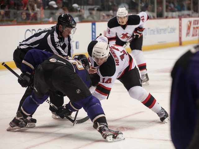 <p>Center Adam Henrique, a star forward during the New Jersey Devils&#39; run for the Stanley Cup during the 2011-2012 NHL postseason, takes a face-off for the AHL affiliate Albany Devils.</p>