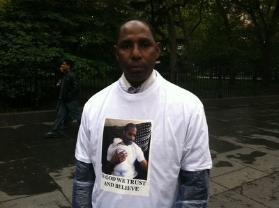 <p>Ibrahim Bah, cousin of Mohamed Bah, says that he family printed 200 t-shirts with his cousin&#39;s image and the words &quot;in God we trust and believe.&quot;</p>