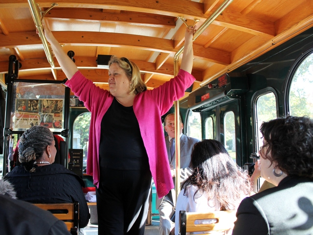 <p>Woodlawn historian Susan Olsen leads a tour of the grounds on the Bronx Culture Trolley, pointing out the gravesites of historic women who are laid to rest at the cemetery.</p>