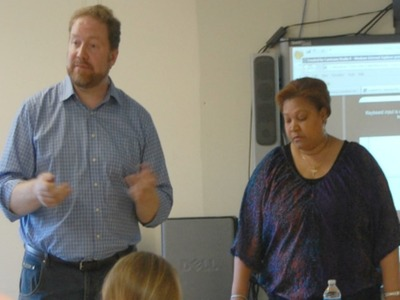 <p>Bryan Davis, chairman of the District 6 CEC&#39;s zoning committee, left, with Belkis Poche, the CEC&#39;s treasurer, at a meeting Oct. 11, 2012.</p>