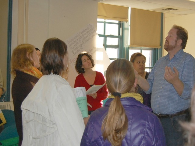 <p>Bryan Davis, chairman of the District 6 CEC&#39;s zoning committee, right, spoke to parents Oct. 11, 2012.</p>