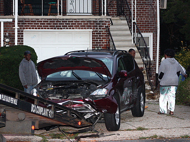 <p>Both the vehicle and the stairs were seriously damaged when an SUV slammed into a home in Canarsie on Oct. 8, 2012.</p>