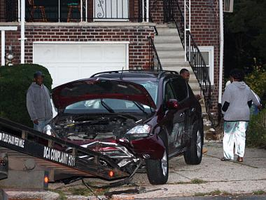 A SUV slammed into a residential building at Farragut Road and East 85th Street in Canarsie, Brookyn, Oct. 8. 2012.