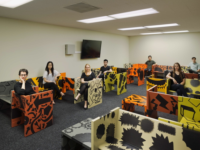 <p>Carin Goldberg (lef) with SVA students posing in chairs they re-purposed as part of a project for a probation center renovation in New York.</p>