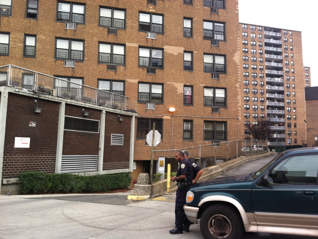 <p>Police guard the apartment building where Noel Polanco lived in Queens to keep press away after Polanco was fatally shot by a police detective on Oct. 4, 2012.</p>