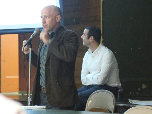 <p>Donovan Finn details the changes each development plan would bring to Flushing Meadows Corona Park at a town hall meeting on Oct. 1, 2012.</p>
