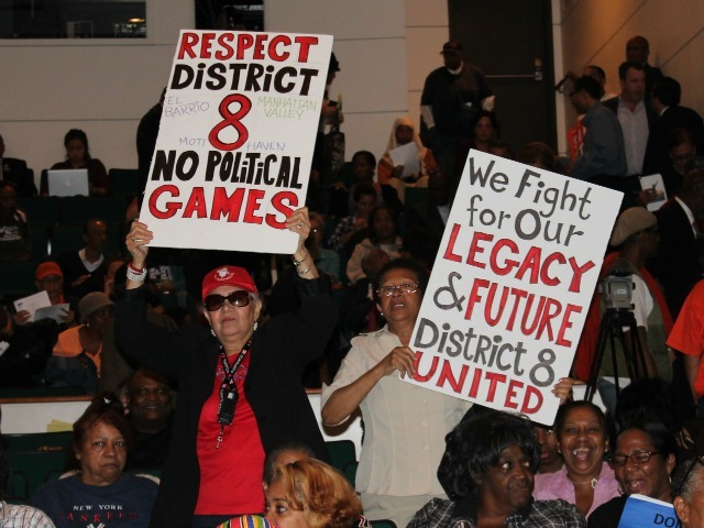 <p>Residents waved signs and cheered and booed during a redistricting hearing in November of 2012.</p>
