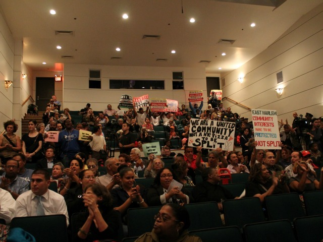 <p>Community members packed the auditorium to protest redistricting changes in November of 2012.</p>
