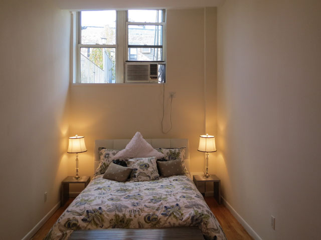 <p>House hunters debated the merits of the bedroom&#39;s long shape in this East Village condo.</p>