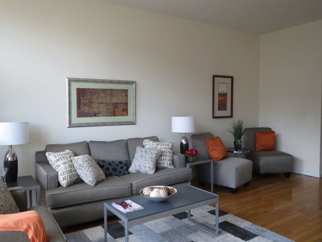 <p>The living room of this East Village condo features wood floors.</p>
