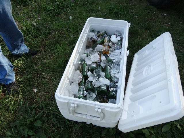 <p>Officers confiscated a cooler filled with beer.</p>