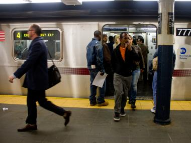 Passengers exit a subway train. Officials announced plans to shut the subway system down if necessary in preparation for Hurricane Sandy, on October 27, 2012.