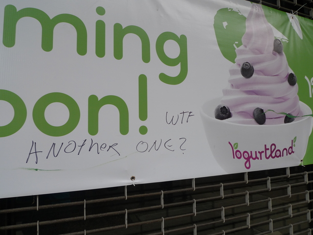 <p>Graffiti on Yogurtland&#39;s &quot;Coming Soon&quot; banner seems to complain about the influx of frozen yogurt shops in Park Slope.</p>
