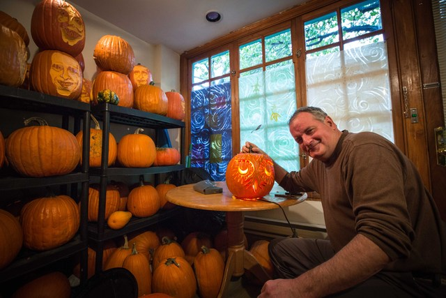 <p>Hugh McMahon and his final product: an owl from the pumpkin</p>