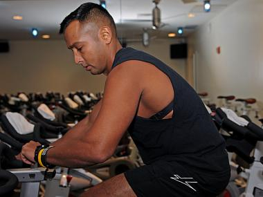 Vik Panda, 34, uses a heart rate monitor while he cycles at the Equinox gym on Greenwich Avenue, Oct. 19, 2012.