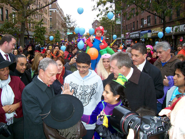 <p>A mini-Mario Brother looks on as Mayor Bloomberg and local politicians greet parade-goers at the&nbsp;Jackson Heights Halloween Parade.</p>