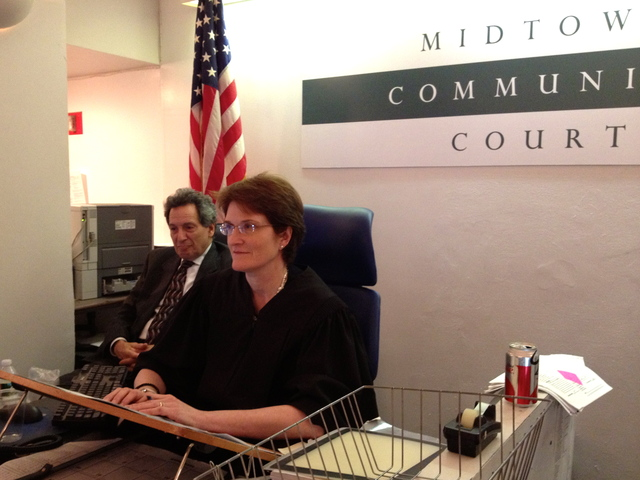 <p>Judge Felicia Mennin presides over the first day of youth court in Midtown Community Court, October 17, 2012.</p>