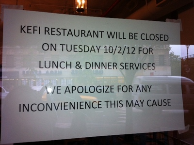 A sign informing diners of Kefi's closure.