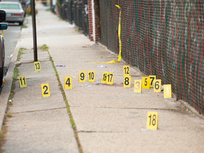 <p>Evidence markers dot the shooting scene on Hemlock Street and Blake Avenue in Brooklyn on Oct. 22, 2012. .</p>