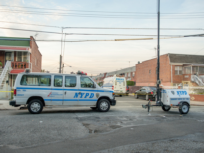 <p>Police at the scene of a fatal shooting on Hemlock Street on Oct. 22, 2012.</p>
