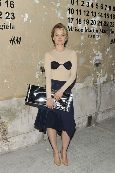 <p>Mena Suvari at the lunch of Maison Martin Margiela for H&amp;M at 5 Beekman in the Financial District, Tuesday, October 23, 2012.</p>