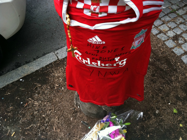 <p>The memorial consisted of a bouquet of flowers and a soccer jersey, on which was written &quot;Mike Jones: Gone but never forgotten.&quot;</p>