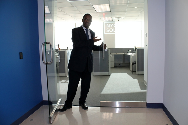 <p>Paul Smith, director of the NYC Business Solutions Center in the Bronx, shows off the new Fordham Road space. They were previously located in the south Bronx.</p>