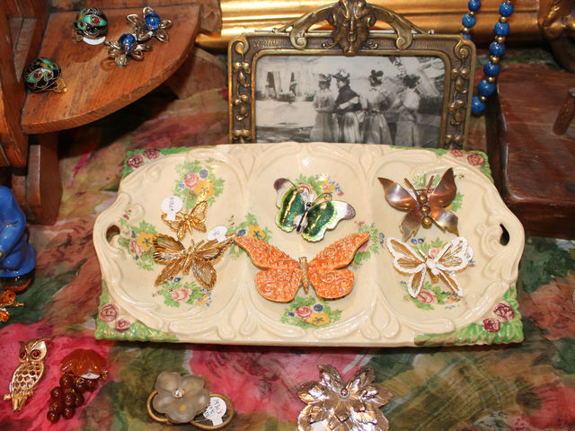 A collection of butterfly pins at Pippin.