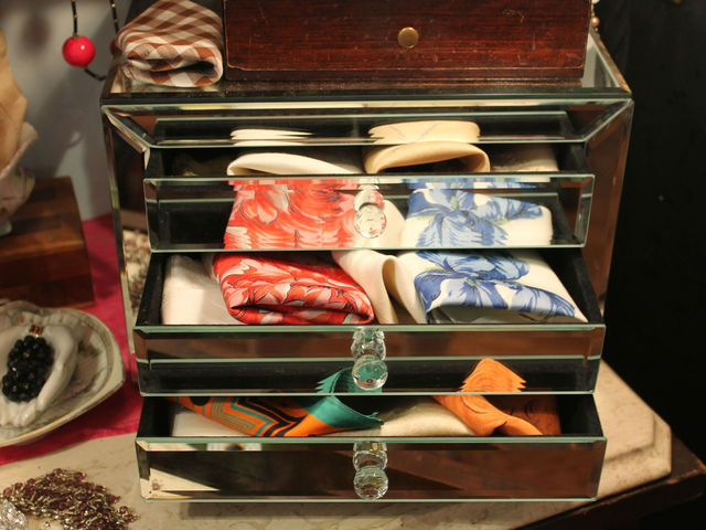 <p>Silk scarves in a vintage jewelry box.</p>