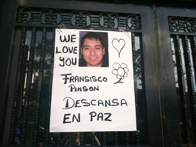 <p>A poster for Francisco Pinzon-Martinez, 30, an employee at a Broadway Metro PCS store, who was found dead in a storeroom on October 19, 2012.</p>
