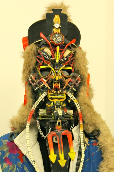<p>The artist Rammellzee often wore the multicolored, multimedia masks he made.</p>