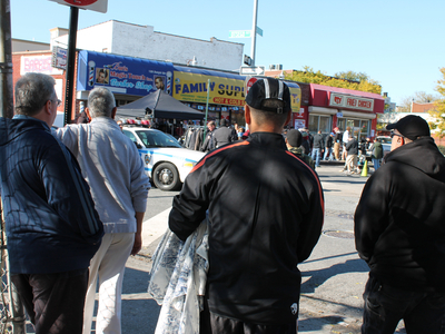 <p>Red Hook residents watch crew members film a scene for CBS&#39;s upcoming cop drama &#39;Golden Boy&#39; on Dwight Street Monday morning, Oct. 22, 2012.</p>