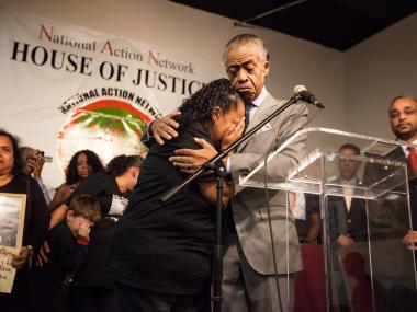 The Rev. Al Sharpton joins Cecilia Reyes, 46, the mother of Noel Polanco, 22, at the National Action Network in Harlem on Saturday Oct. 6th, 2012. Polanco was shot and killed by an NYPD detective Thursday.