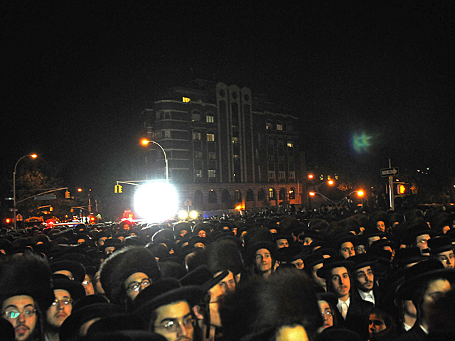 <p>Thousands of Satmar Hasidic Jews gathered along Bedford Avenue to watch their rabbi&#39;s grandson, Chaim Hersch Rosenberger, marry Classoner Rav Scher, Oct. 17, 2012.</p>